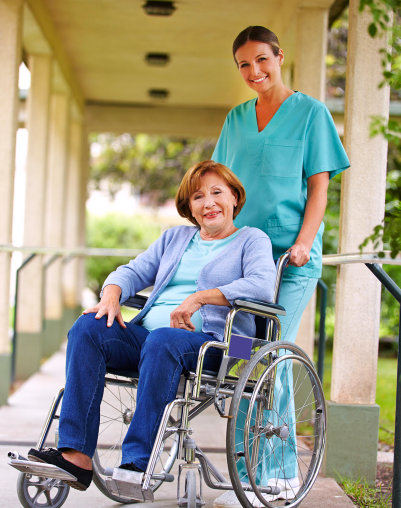 elderly woman in wheelchair with her caretaker