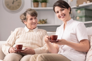 caregiver and senior female smiling